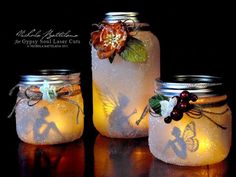 Fairy lanterns, made with paper fairy cutouts, mason jar, clear glitter, flower, and twine.