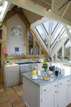 Kitchen with a wall of cleverly designed windows.