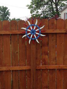 Repurposed cultivator wheel to yard art