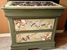 Old wood nightstand designed and painted by Designs by Denise.  Painted in Annie Sloan Chalk Paint in Olive, Top and drawers painted in ASCP in Versailles. Decoupage on top as well as drawer faces. Branches and some leaves hand painted. Craqueleur added to top with dark wax. All sealed with clear wax. www.Facebook.com/DeniseMarieSaylorFineArts Available: $225
