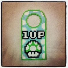 1Up door hanger hama beads by  cowabungram