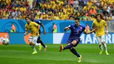 Robin van Persie of The Netherlands scores a penalty at the World Cup Brazil 2014