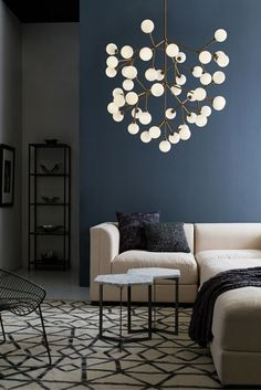 Make a jaw dropping statement with the Mara Grande LED chandelier from Tech Lighting. It is a wholly modern interpretation of classic multi-tier chandelier, but rarely does a fixture provide such dramatic impact. Whether you select the on-trend aged brass finish or the plated satin nickel finish, each large chandelier features 45 individual frosted glass globes which smoothly diffuse the LED light sources for an unmistakably high-end look. Ideal for living room lighting.