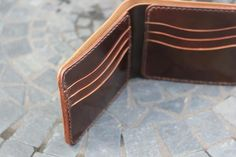 Handmade and Handcrafted in the USA. Bifold wallet features multiple available custom configurations. Available in Horween Chromexcel or Shell Cordovan.