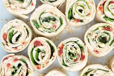 These Sun-Dried Tomato, Basil and Spinach Pinwheels make a perfect party appetizer or light lunch. They take about 15 minutes to make and are a healthy alternative to pinwheels made with cream cheese. | APPETIZERS| LUNCH | VEGETARIAN | VEGAN | ROLL UPS | PINWHEELS | Recipe at OatandSesame.com