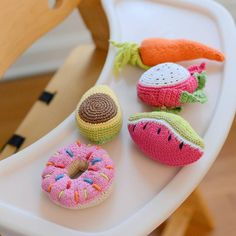 Photoshoot Sneak Peek!   Can you spot the two Pebble Food Rattles new for 2017?  #pebble #pebblechild #purchasewithpurpose #handmade #fairtrade #fairtrade360 #veggies #foodie #highchair #snack #donut #watermelon #carrot #healthy #healthykids #avocado #dragonfruit #sprinkles
