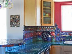 Multicolor: Intricate Handmade Tiles - 30 Bright, Bold and Colorful Kitchens on HGTV--love the jewel-tones in this backsplash!  Very Pershian inspired