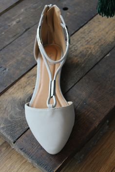 Gray pointed toe flat with a rear zip closure and a T-strap structure with silver metallic accents.