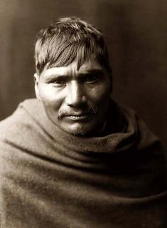 You are looking at an educational picture of a Yaqui Indian Man. It was taken in 1907 by Edward S. Curtis.    The picture presents this man in a head and shoulders portrait. He is wrapped in an Indian Blanket.    We have created this collection of pictures primarily to serve as an easy to access educational tool. Contact curator@old-picture.com.
