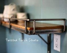 Cedar and steel kitchen shelf!  Visit stonecountyironworks.com for more amazing wrought iron designs!