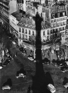 place de la bastille, 1957. the shadow of the column built in memory of the victims of the trois glorieuses of fighting (27, 28, 29 july 1830), which put an end to the reign of charles x.  © willy ronis, from paris. portrait of a city.