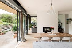 For Sale: Frog Lane, Cuddington, Buckinghamshire | The Modern House Bright Hallway, Mad About The House, Dark Curtains, Internal Courtyard, Minimal Kitchen, The Door Is Open, Cosy Corner, Log Burner, Timber Flooring