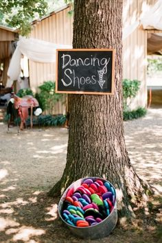 Fantastic idea to get people up and   dancing even if they are wearing heels! Have pairs of flip flops for people to   borrow and it means everyone can join in the celebration even if they only   bought 3 inch heels! A lovely touch would be to write yours names and the   wedding date on each flip flop and then people can take them home as a   memento!