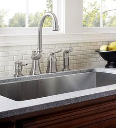 Stylish Faucets - nice big sink stainless steel too so easy to keep clean and hygienic