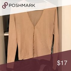 Blush cardigan This thin blush colored cardigan features gold tone buttons Sweaters Cardigans
