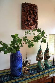 Asian corner of my living room!! Teppanom statues from Thailand. Saraswati carving