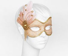 Handmade Venetian style masquerade mask. Front side is covered with glittered nude fabric. Decorated with nude feathers, gold faux leather braided trim,