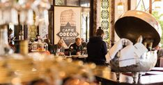 Be sure not to miss the Odeon – the legendary café is a crowd-puller from morning to night. Stefan Zweig, Vintage Fans, James Joyce, Tourist Information, Cafe Bar, Close To My Heart, Albert Einstein, Public Transport, The Locals