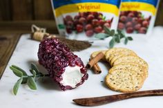 A recipe for creating a cranberry cheese log using Craisins® Dried Cranberries; it's the perfect appetizer to serve your guests this holiday season!