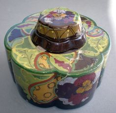 Ivora Gouda pottery inkwell A Gouda pottery inkwell brand Ivora with six rounded sides with removable lid and inkwell. The diameter is 9.8 cm, height 7.5 cm with lid. At the bottom is marked this inkwell and numbered.  Model 152, inkwell. Part of the varied history of Plateelbakkerij Zuid-Holland (PZH). For history of PZH see:  http://www.goudadesign.co.uk/collectorsgallery19.html