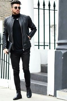 Pair a black quilted leather bomber with black skinny jeans for a comfortable outfit that's also put together nicely. Black leather chelsea boots will instantly smarten up even the laziest of looks. Shop this look on Lookastic: https://lookastic.com/men/looks/bomber-jacket-turtleneck-skinny-jeans/22418 — Black Sunglasses — Black Turtleneck — Black Quilted Leather Bomber Jacket — Black Leather Zip Pouch — Black Skinny Jeans — Black Leather Chelsea Boots