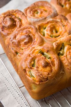 With a crisp cheddar encrusted exterior and pillowy layers of buttery brioche and melted cheddar on the inside, these Jalapeño Cheddar Rolls are irresistibly good.