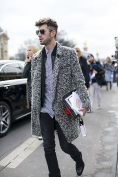 Shop this look on Lookastic: https://lookastic.com/men/looks/overcoat-bomber-jacket-dress-shirt-jeans-chelsea-boots-zip-pouch/8432 — White and Black Vertical Striped Dress Shirt — Black Leather Bomber Jacket — Grey Overcoat — Black Leather Zip Pouch — Black Jeans — Black Leather Chelsea Boots