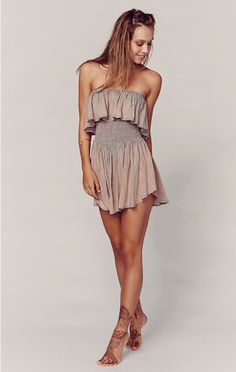 The most perfect outfit for the upcoming summer / festival season by Blue Life! Featuring warm tie dye colors and a smocked waist, this strapless romper with an elasticized neckline will have you turning heads everywhere you go.