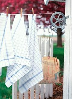 Laundry Day.  Do people still hang their laundry out?  I LOVED the smell of bedding when it came indoors.