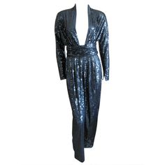 Halston 1970's disco era sexy sequin jumpsuit with belt | From a collection of rare vintage suits, outfits and ensembles at http://www.1stdibs.com/fashion/clothing/suits-outfits-ensembles/