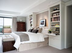 I like the built in bookcases/night tables that frame the bed.  Interesting idea.