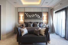 Master bedroom design by Rachel Winham Interior Design, featuring a starburst headboard design, inset wall lighting and porcelain wall sculptures. www.rachelwinham.com