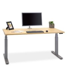 UpCentric electric standing desk by Ergocentric. Sit or stand with the UpCentric height adjustable table in Canada. Ergonomic stand up desk made in Canada by ErgoCentric.