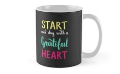 Start each day with a grateful heart. Colorful text on dark background. by kakapostudio