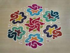 Beautiful and colourful sangu kolam design with 19 x 10 interlaced dots. Latest rangoli kolam design for festivals like diwali, pongal, new year etc. Simple Rangoli Designs Images, Rangoli Designs Flower, Small Rangoli Design, Rangoli Ideas, Rangoli Designs With Dots, Rangoli Designs Diwali, Flower Rangoli, Rangoli With Dots, Beautiful Rangoli Designs