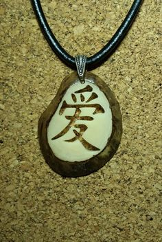 Check out this item in my Etsy shop https://www.etsy.com/listing/109021696/chinese-caligraphy-symbol-love-tagua
