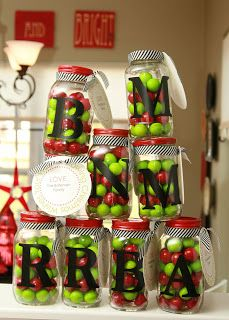 """bubble gum or candy or treat filled monogrammed jars.  paint the lids, add a letter sticker or paint one on and fill up!    add a note that says """"happy holidays etc to a wonderful family!""""  blah blah blah something of this sort."""
