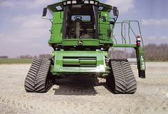 Saw one of these today, in Norfolk England.  John Deer combine harvester, with front caterpillar tracks.