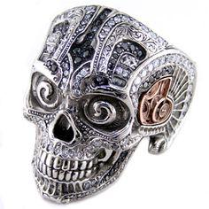 Model 46 palladium and rose gold skull ring filled with black & white diamonds