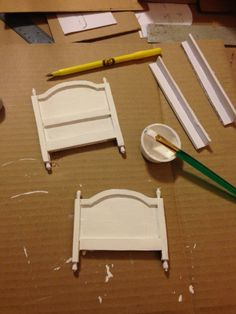 When I get tired of putting on stones, I make other things. I found this bed tutorial at 1 inch minis by kris. I did alter the design a little, though. This is made from cardboard and paper. I think she uses mat board.