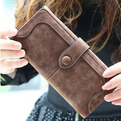 A hasp-snap secures this versatile clutch. Wrapped in richly textured faux leather; it's chic as a minimalist clutch. Go sleek and sophisticated for date night and special occasions featuring plenty of pockets to keep your evening essentials organized and on hand  The interior features a photo holder, note compartment, multiple card holders, coin pocket, interior slot pocket, and interior pocket.