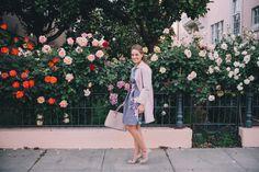 Gal Meets Glam Wall of Roses - Max Mara coat, Ted Baker dress, Salvatore Ferragamo pumps, and Prada bag.