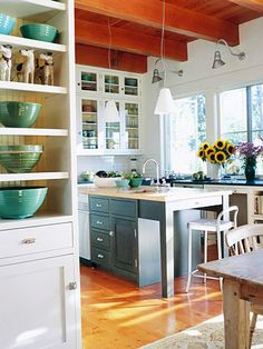 A charming cottage kitchen with open shelving and glass-front cabinetry. More Cottage Style Rooms: http://www.bhg.com/decorating/decorating-style/cottage/cottage-style-rooms/?page=1=bhgpin042412cottagekitchen