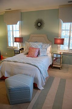 Aqua and orange bedroom. Love the rug, have the pouf, need to add some pops of color.