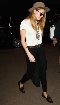Slim black pants with a tucked in white tee, fedora, and leopard loafers.