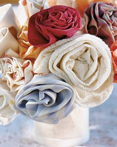 A fashion designer and makeup artist, bride Molly created these fabric flowers for bouquets, boutonnieres, and centerpieces. Each was shaped by hand and has a copper-wire stem.