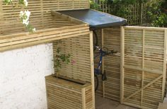 bike shed brightonbikesheds classic, slot in or hanging (as here) suitable for front gardens Bicycle Storage Shed, Bike Shed, Shed Storage, Outside Storage, Outdoor Storage, Back Patio, Small Patio, Cool Sheds, Corner Garden