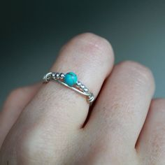 Turquoise stacking ring; This ring features a small turquoise dyed howlite bead with tiny sterling silver beads wire wrapped in solid sterling
