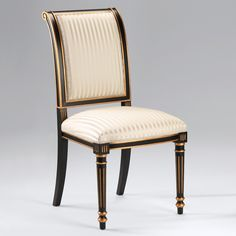 """Regency style carved wood side chair with black finish, antiqued goldleaf trim and striped ivory upholstery; 38¾"""" h. Seat is 20"""" w. x 19"""" d. x 20"""" h. Hand made in Italy."""