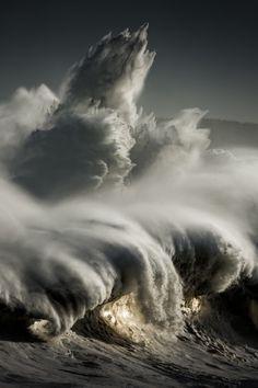 El farobyRicardo Lopez Blanco. Large waves pounding lighthouse, Mouro island, Santander, Spain